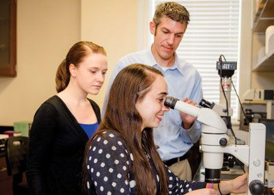 Dr. Christopher Meighan with students