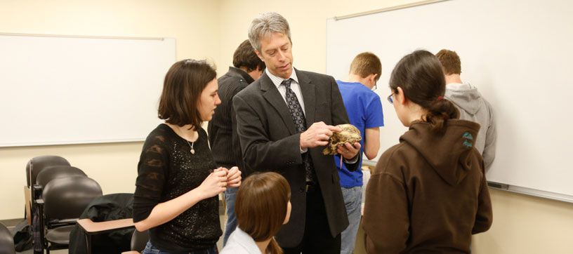 Dr. Loy working with anthropology students in class