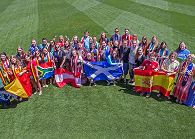 Students on the Great Lawn holding international flags