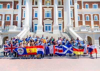 Students holding international flags