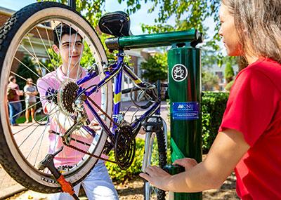 Students fixing a bike