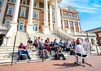 Class sitting on CNH stairs