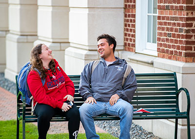 Students laughing on the Great Lawn
