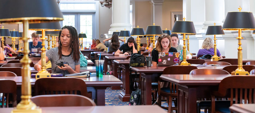 Students studying in reading room