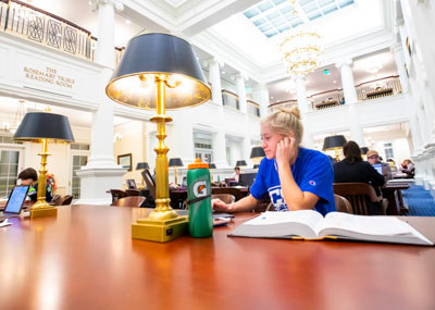 Female student studying in the Trible Library reading room