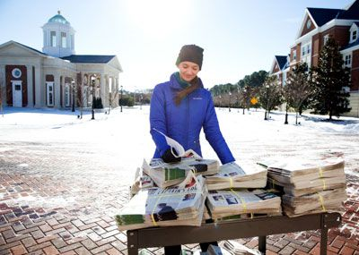 Captains Log newspapers being delivered in the snow