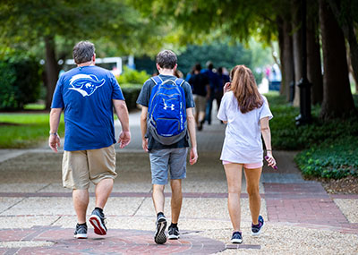 Rear shot of family walking on campus