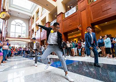 Greek Life pledges dance in the David Student Union