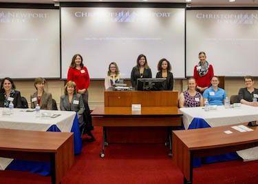 Society of Women Engineers members pose with CNU students.