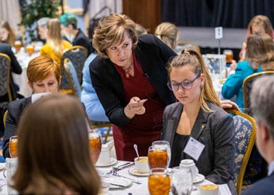 Lynne Breil, president of The Professional Edge, instructs senior electrical engineering major Tatiana Pickard.