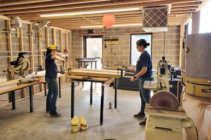 Cheyanne Dwyer '16, left, and Cecily Wynne '17 build wooden molds used to produce emergency face masks.
