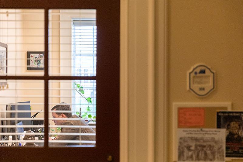 Dr. Frank Garmon Jr. teaches an online course in his office