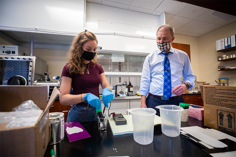 Dr. Ronald Quinlan (right) and a student working in the chemistry lab