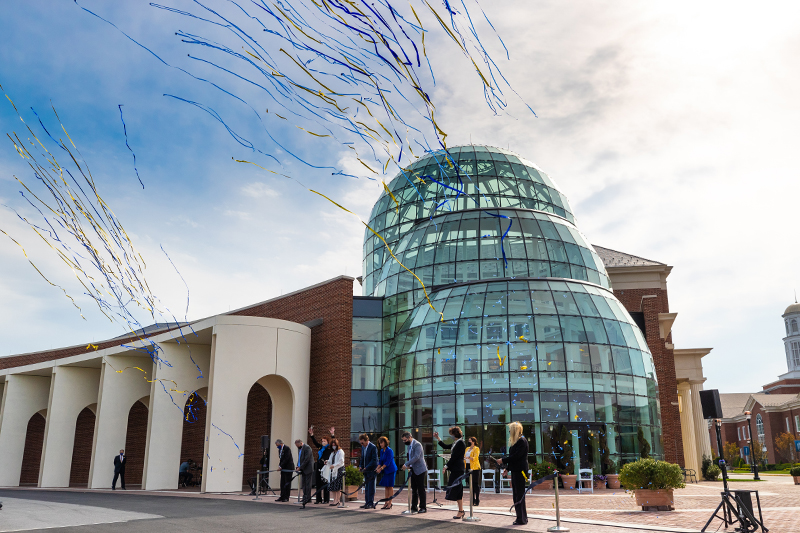 Confetti and streamers fly as the ribbon is cut at the soft opening for the Mary M. Torggler Fine Arts Center.
