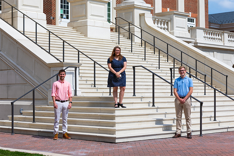 Jonathan Sicher, Holly Foster and David Harrop on the steps of Christopher Newport Hall