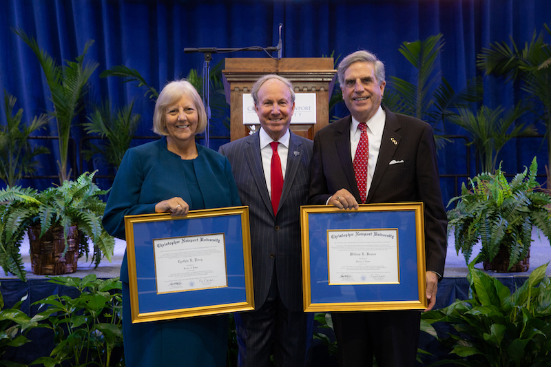 Cindi Perry and Bill Brauer pose with their honorary degrees with President Trible