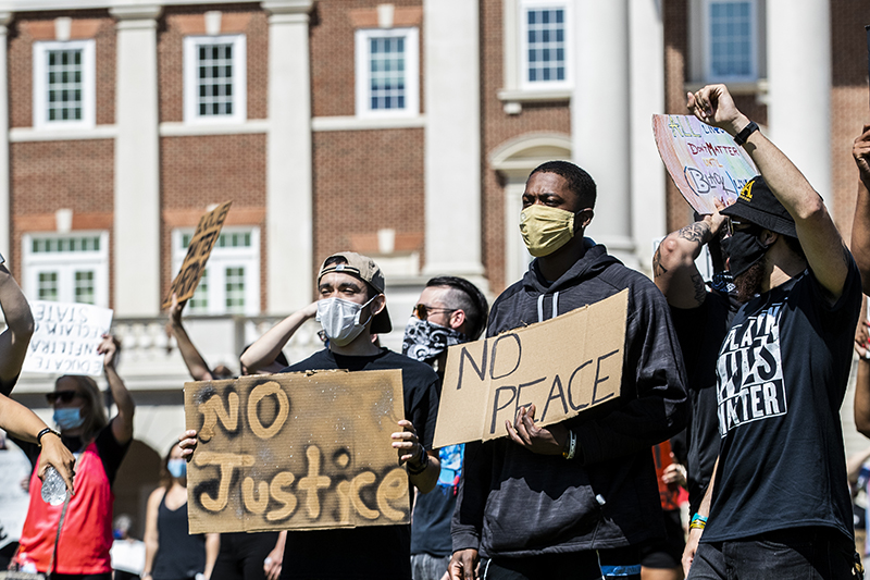CNU students hold signs at a Black Lives Matter rally on campus during the summer of 2020