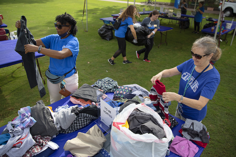 2 women sort clothes on the Great Lawn