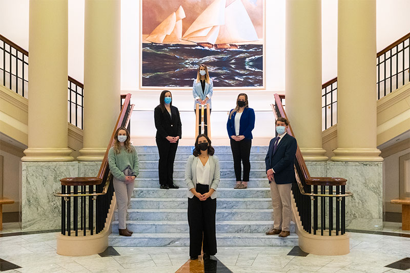 Six leadership studies majors on the Trible Library rotunda steps