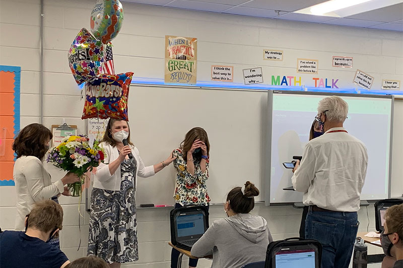 School staff surprise Megan Harris with the Gloucester County Teacher of the Year Award
