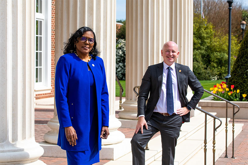 Jeion Ward (left) and Mike Mullin in front of Pope Chapel on campus at CNU