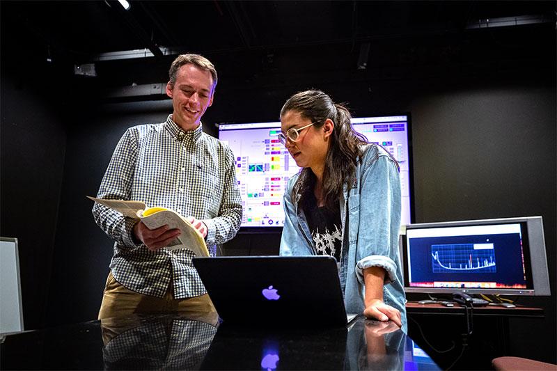 Kaemon Watada (right) with Dr. Ryan Fisher in the LIGO lab on campus at CNU