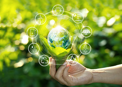 Hand holding light bulb against nature on green leaf with icons energy sources for renewable, sustainable development