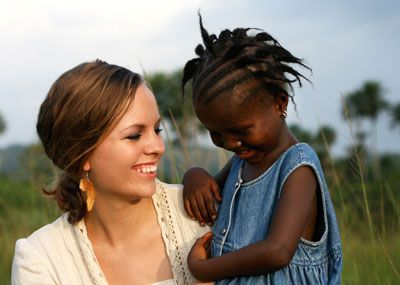 Woman with young African girl