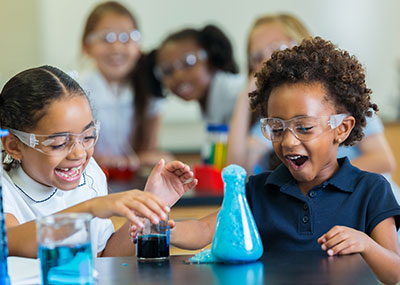 Girls performing a chemistry experiment