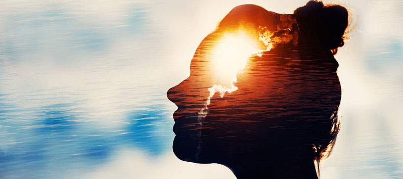 Woman's head in silhouette with sky