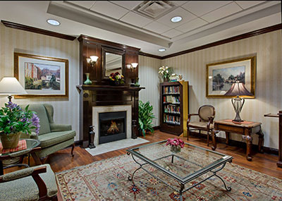 Country Inn and Suites interior lobby with chairs and a fireplace
