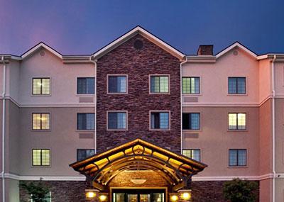 Staybridge Suites exterior at sunset