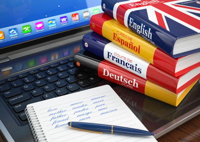 Language course books with laptop