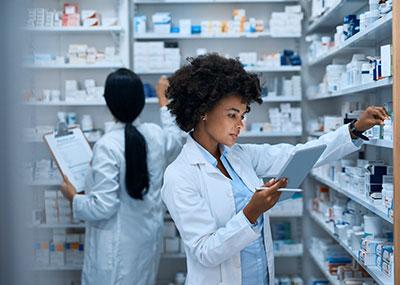 Two pharmacists fill prescriptions