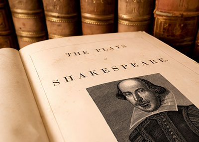 Open book titled The Plays of Shakespeare