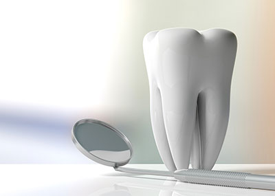 Big model of a tooth with a dentist mirror
